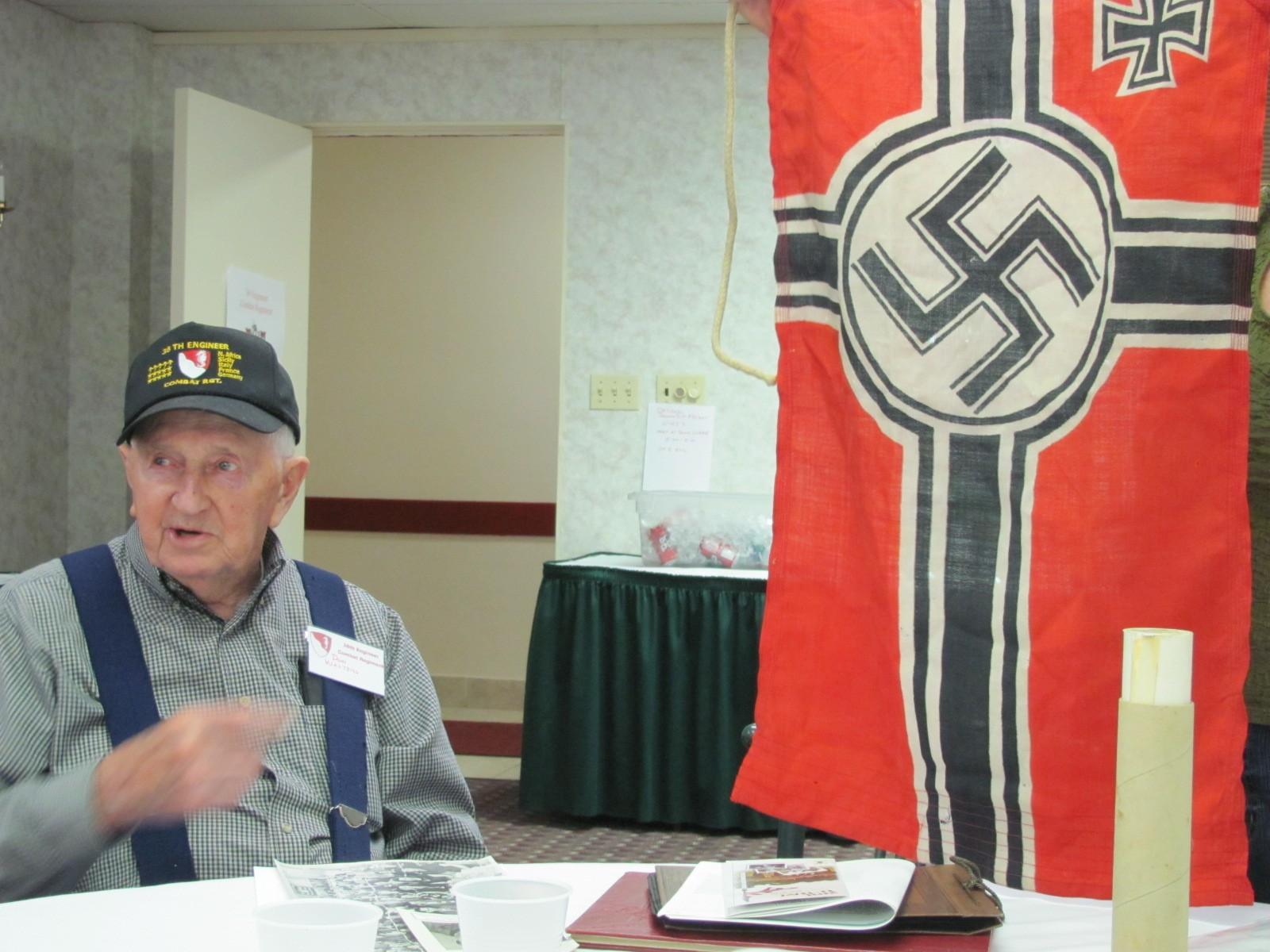 Don with captured Nazi flag.JPG