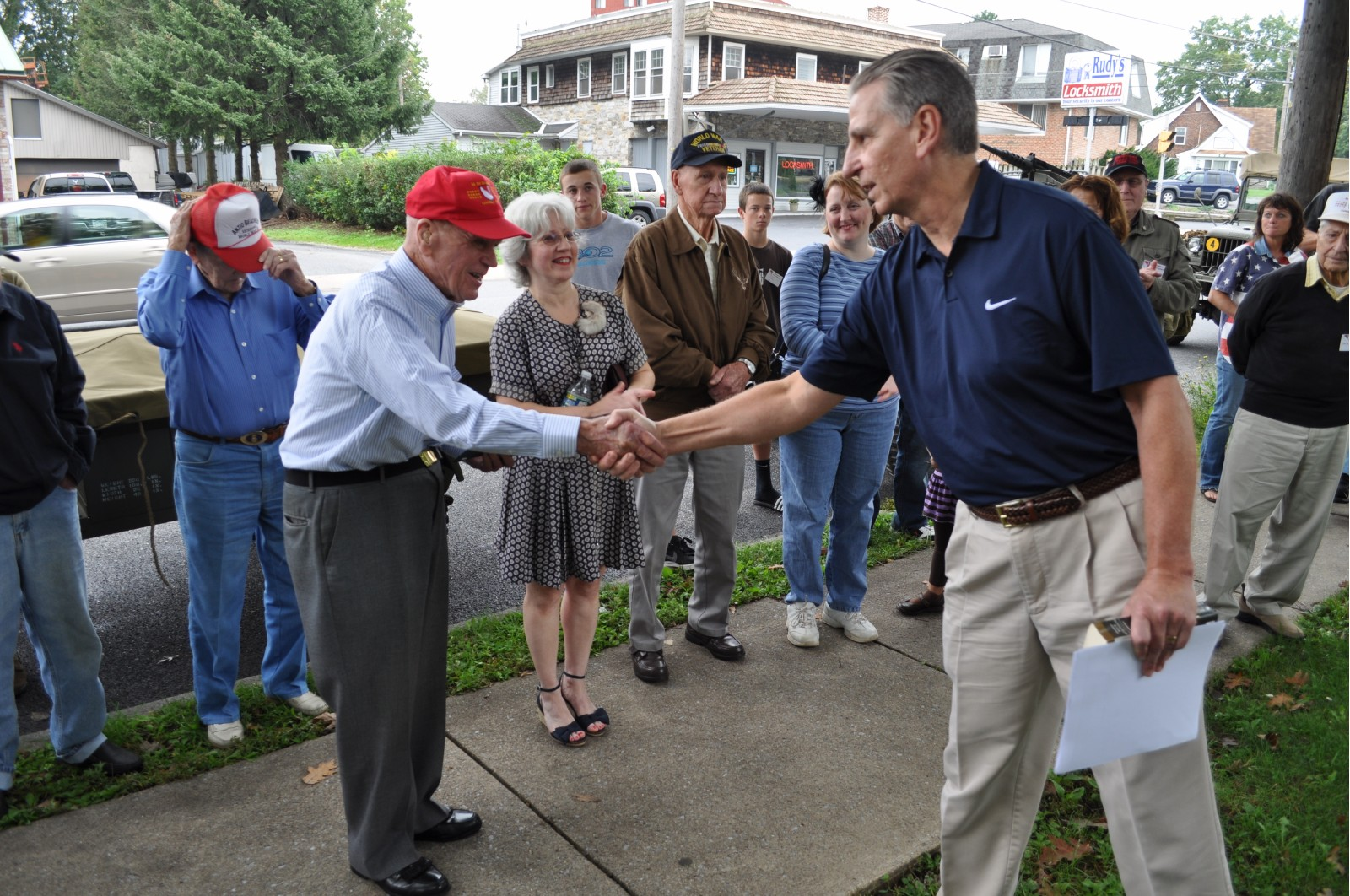 veteran's order - John shaking hands with city counsel member.JPG