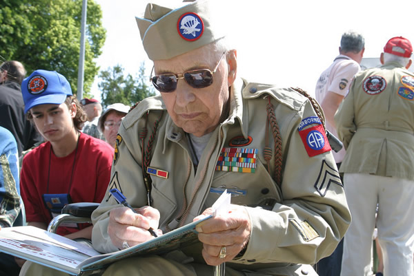 Howard signs D-Day History book